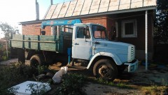 Замопогрузчик ЗИЛ с КМУ Тадано 260